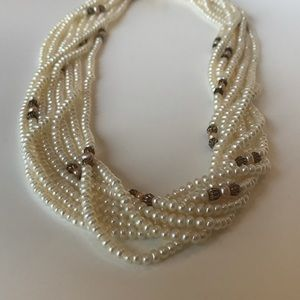 Seed pearl necklace with gold tone metallic beads.